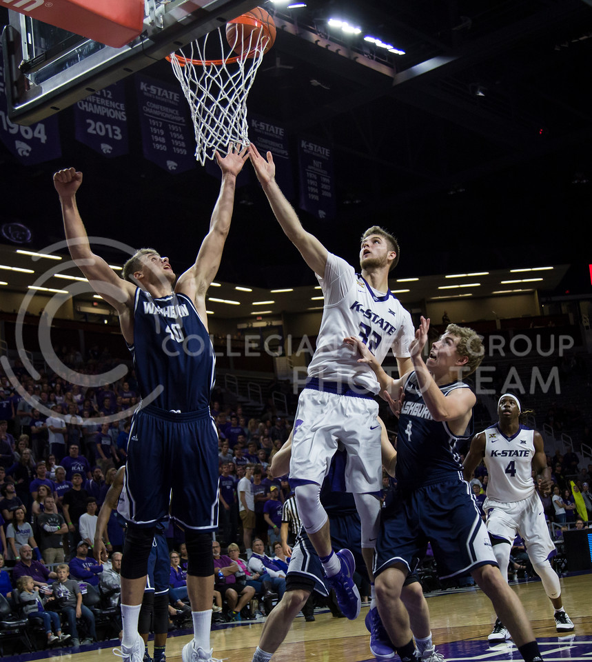 Sophomore forward Dean Wade assists a shot on the basket during the K-State game against Washburn in Bramlage Coliseum on Nov. 4, 2016. (Nathan Jones | The Collegian)