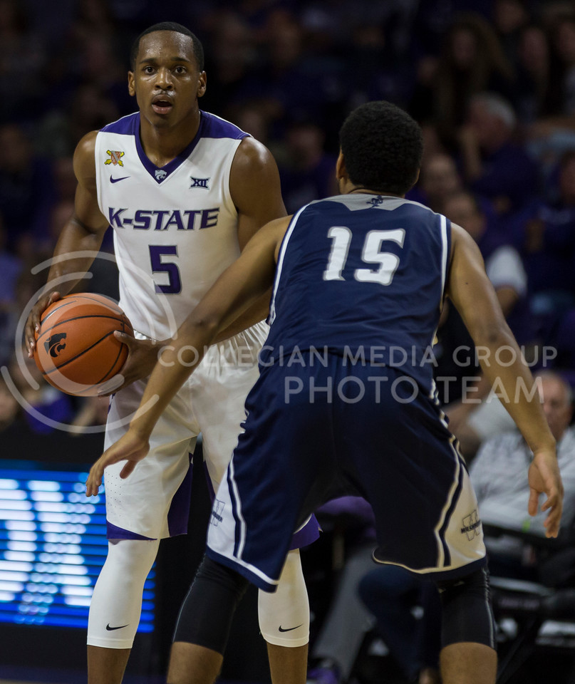 Sophomore guard Barry Brown looks for an open spot to pass during the K-State game against Washburn in Bramlage Coliseum on Nov. 4, 2016. (Nathan Jones | The Collegian)