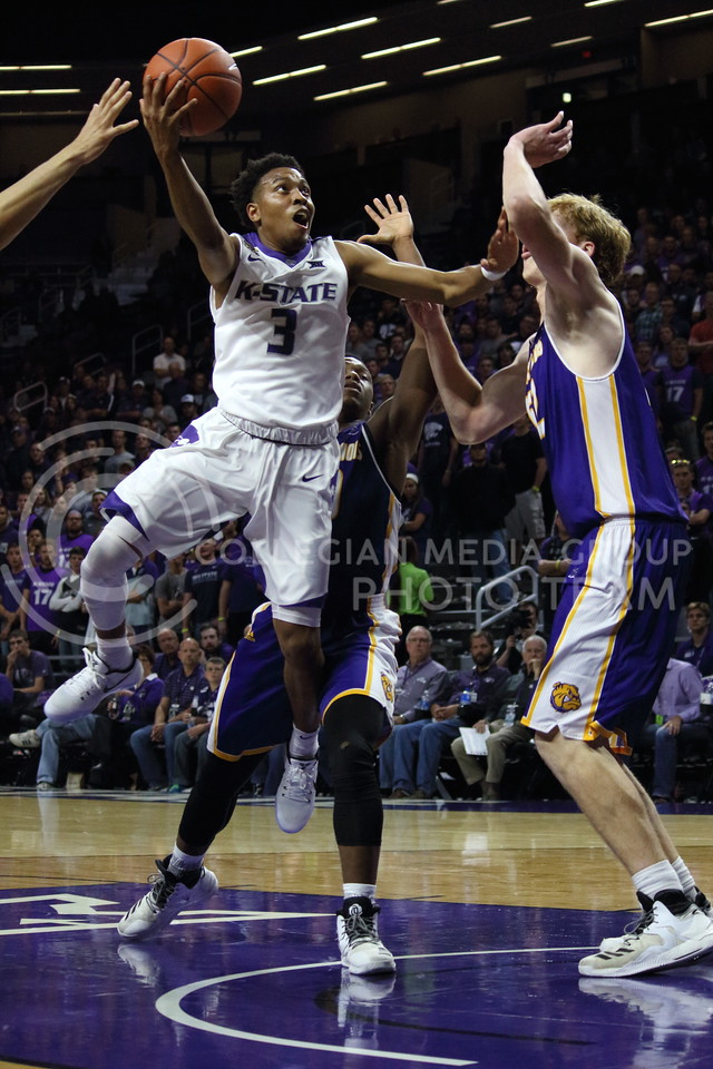 Sophomore guard Kamau Stokes takes a shot at the basket  during the K-State game against Western Illinois in Bramlage Coliseum on Nov. 11, 2016. (Miranda Snyder | The Collegian)