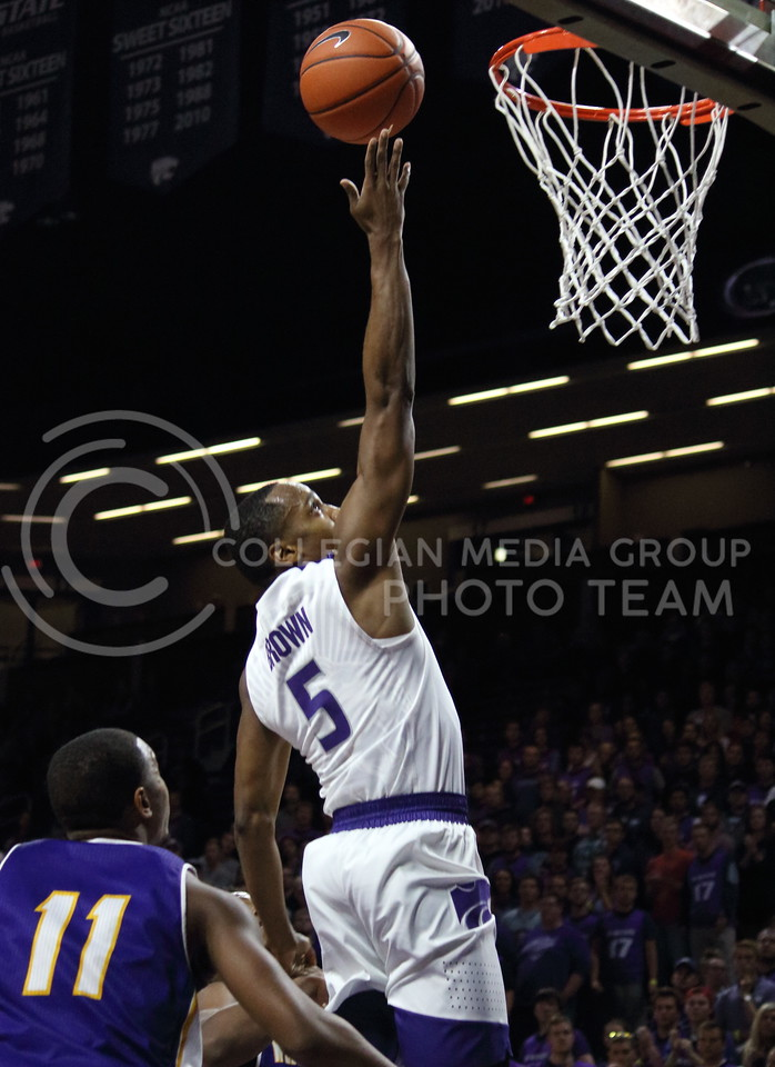 Sophomore guard Barry Brown takes a shot during the K-State game against Western Illinois in Bramlage Coliseum on Nov. 11, 2016. (Miranda Snyder | The Collegian)