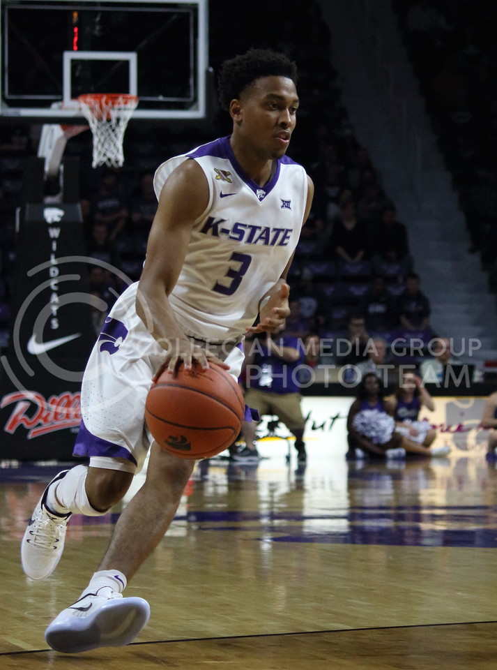 Sophomore guard Kamau Stokes dribbles the ball during the K-State game against Western Illinois in Bramlage Coliseum on Nov. 11, 2016. (Miranda Snyder | The Collegian)