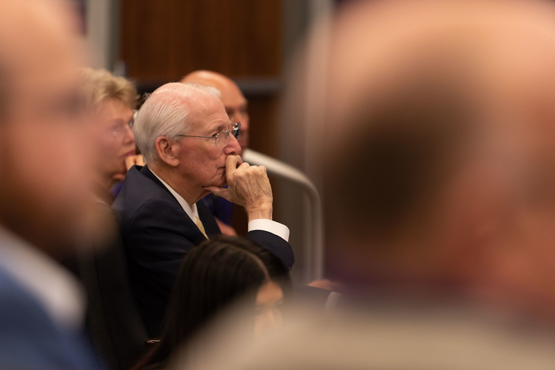 Former head coach Bill Snyder listens to the new head coach Chris Klieman at the press conference held in the Vanier Complex on Wednesday. Klieman said he is willing to step into those shoes. Klieman was welcomed to Manhattan on Wednesday, Dec. 12, 2018, to head into the next football season. (Olivia Bergmeier | Collegian Media Group)