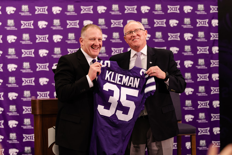 New head coach Chris Klieman and K-State athletic director Gene Taylor hold up a jersey with Klieman's name on it and the number 35. Klieman was welcomed to Manhattan on Wednesday, Dec. 12, 2018, to head into the next football season. (Olivia Bergmeier | Collegian Media Group)