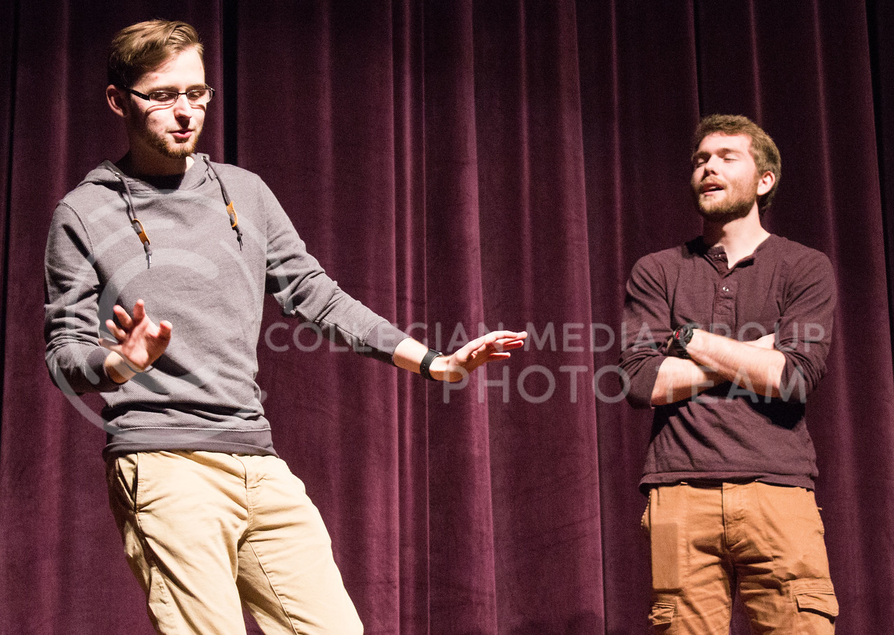 Mason Swenson, junior in mass communications, and Dewey Molenda, senior in statistics, perform at On The Spot Improv's first performance of the year in Forum Hall on Jan. 24, 2017. (Regan Tokos | The Collegian)
