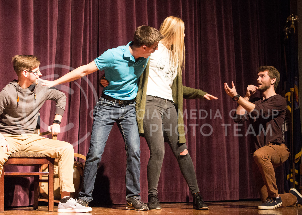 From left to right, Mason Swenson, junior in mass communications, Jack Dotterweich, sophomore in secondary education, Olivia Carter, freshman in theatre, and Dewey Molenda, senior in statistics, perform at On The Spot Improv's first performance of the year in Forum Hall on Jan. 24, 2017. (Regan Tokos | The Collegian)