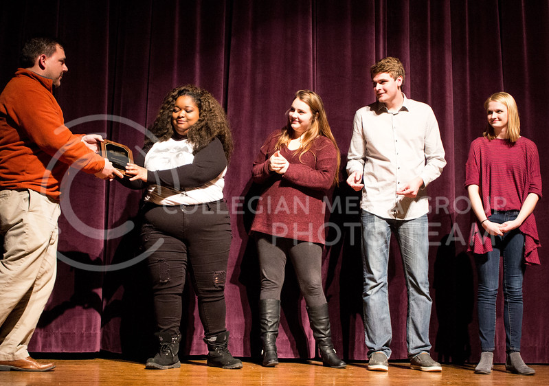 The improv group Black and White and Red All Over recieve an award from thier advisor after winning the College Improve Heartland Regional. Team members include Casha Mills, senior in English, Nate Kochuyt, freshman in theater, Brigid Reilly, senior in theater, and Emma Pirotte, freshman in secondary education. (Regan Tokos   The Collegian)