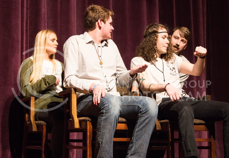 From left to right, Olivia Carter, freshman in theatre, Nate Kochuyt, freshman in theatre, Mitchel Yarnell, freshman in environmental design, and Ryan Woods, senior in fine arts, perform at On The Spot Improv's first performance of the year in Forum Hall on Jan. 24, 2017. (Regan Tokos   The Collegian)