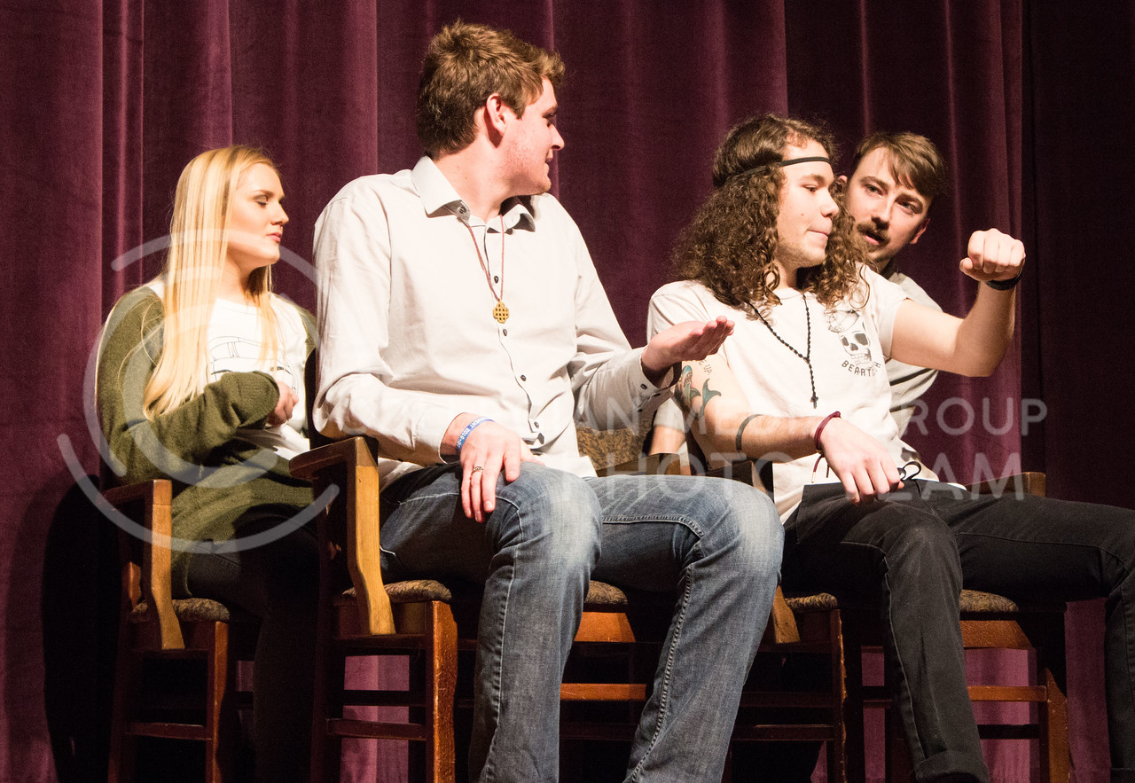 From left to right, Olivia Carter, freshman in theatre, Nate Kochuyt, freshman in theatre, Mitchel Yarnell, freshman in environmental design, and Ryan Woods, senior in fine arts, perform at On The Spot Improv's first performance of the year in Forum Hall on Jan. 24, 2017. (Regan Tokos | The Collegian)