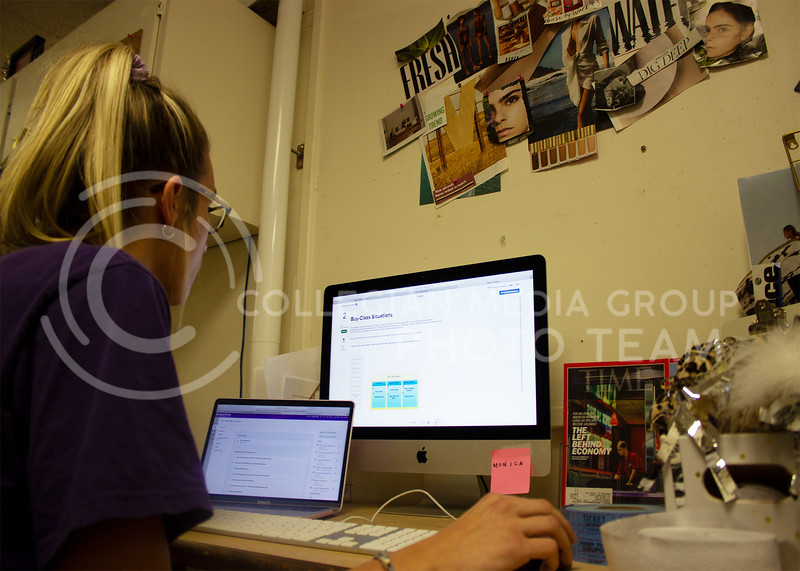 Chloe Byers, sophomore in marketing, multi-tasks to do her homework online using her laptop and an iMac monitor in Kedzie hall. (Paige Eichkorn | Collegian Media Group)