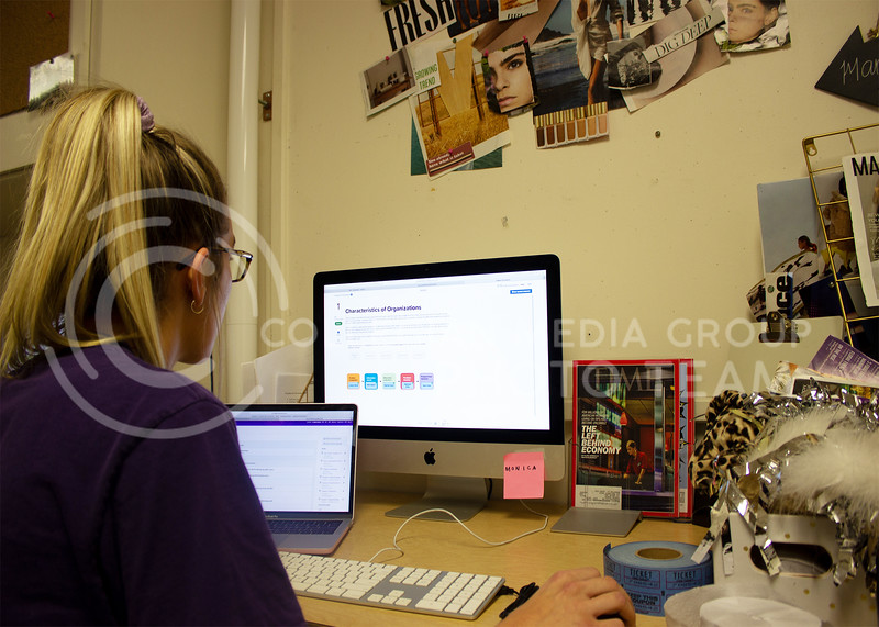 Chloe Byers, sophomore in marketing, starts on her homework using McGraw Hill Connect to submit it online. (Paige Eichkorn | Collegian Media Group)