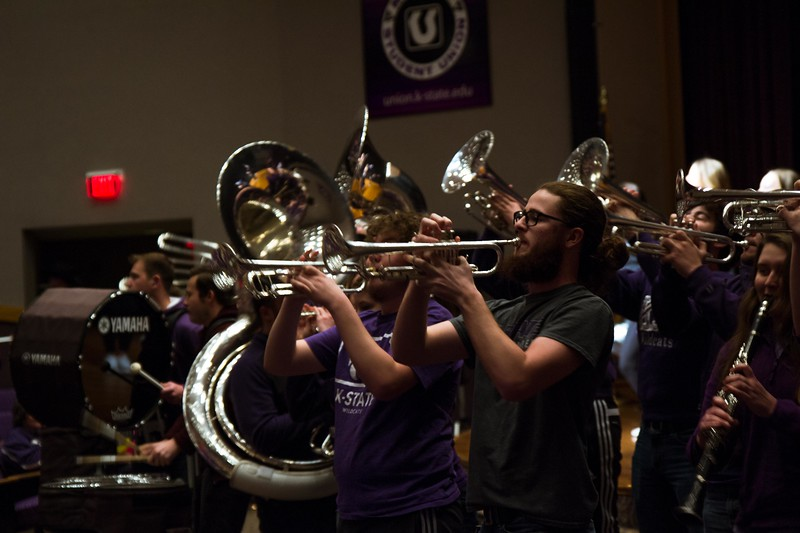 The K-State wabash cannonball plays loud and clear as the marching band blasts through Forum Hall at Open house on Saturday, April 7. Different K-State groups displayed their K-State pride for visitors at Open House putting on a great show for all.  (Hannah Greer | Collegian Media)