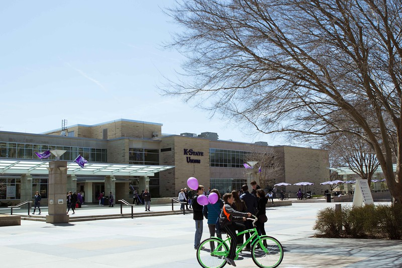 Outside the K-State Union visitors gather at the heart of campus at Open House on Saturday, April, 7. K-State's Open House was filled with fun activities, food, and plenty of opportunities to explore the vast options K-State has to offer. (Hannah Greer | Collegian Media)