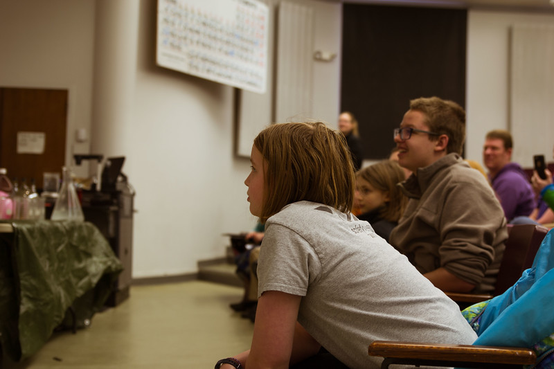 The kids pay close attention as K-State chemistry students put on an intriguing demonstration at Open House on Saturday, April 7. The Open House held several shows for visitors across the state to convey K-State's excellence. (Hannah Greer | Collegian Media)