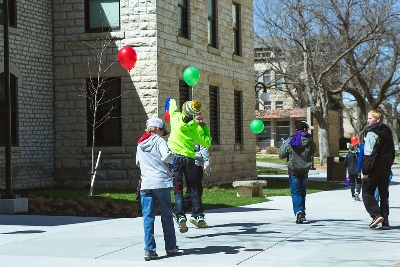 The kids of  K-States Open House on Saturday, April 7 jump for joy after a fun filled day of all the activities the University has to offer.  (Hannah Greer | Collegian Media)