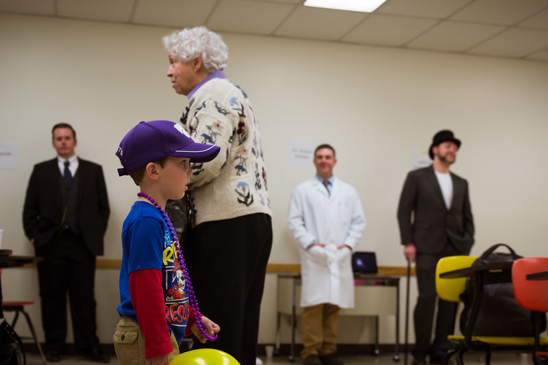 Both the old and the young come to enjoy the education department's live wax museum at Open House on Saturday, April 7 where K-State education majors dressed as historical figures. During K-State's Open House the education department filled Bluemont with fun activities in the science room, the animal room, the living wax museum, and other fun filled rooms. (Hannah Greer | Collegian Media)