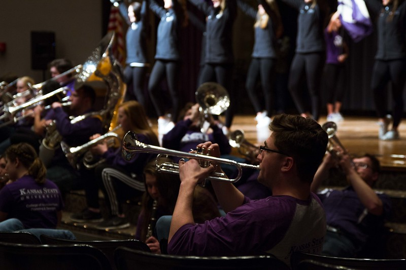 The trumpets are blown and the marching band and drum line play to show visitors K-State's pride and excitement. Different K-State groups displayed their K-State pride for visitors at Open House putting on a great show for all.   (Hannah Greer | Collegian Media)