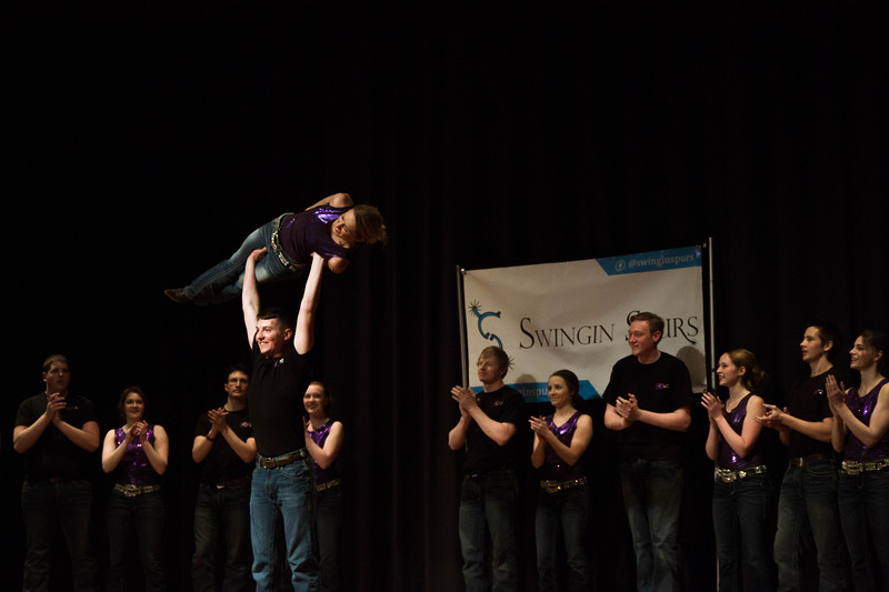 It's all smiles for the Swingin' Spurs as the wow the audience with their impressive lifts at Open House on Saturday, April 7. Different K-State groups displayed their K-State pride for visitors at Open House putting on a great show for all. (Hannah Greer | Collegian Media Group)