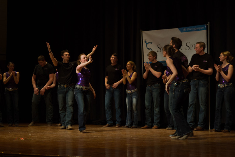 In their final dance number the Swingin' Spurs couple up and go head to head with their tricks to impress the audience at K-State's Open house. Forum Hall was full of live performances on Saturday, April 7 for visitors coming to see the joys of attending K-State.  (Hannah Greer | Collegian Media)