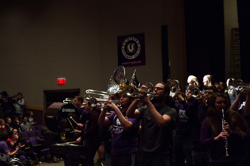 The K-State marching band and drum line proudly played for the visitors of Open house on Saturday, April 7 with their traditional Wabash Cannonball. Different K-State groups displayed their K-State pride for visitors at Open House putting on a great show for all.   (Hannah Greer | Collegian Media)