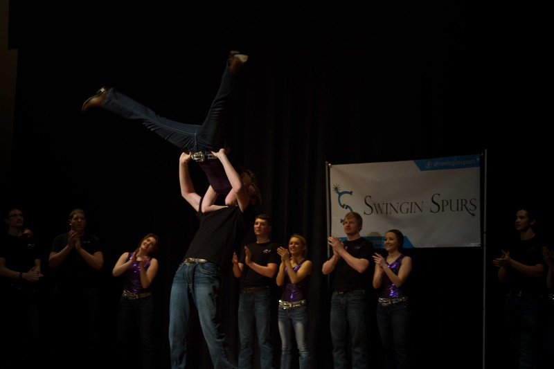 The Swingin' Spurs packed the last five minutes of their performance with various tricks and lifts at Open House on Saturday, April 7. Different K-State groups displayed their K-State pride for visitors at Open House putting on a great show for all. (Hannah Greer | Collegian Media Group)