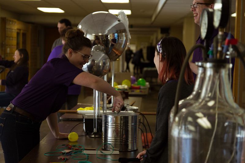 Different physics activity stands are set up at Open House on Saturday, April 7 for everyone to enjoy. K-State's Open House was filled with fun activities, food, and plenty of opportunities to explore the vast options K-State has to offer. (Hannah Greer | Collegian Media)