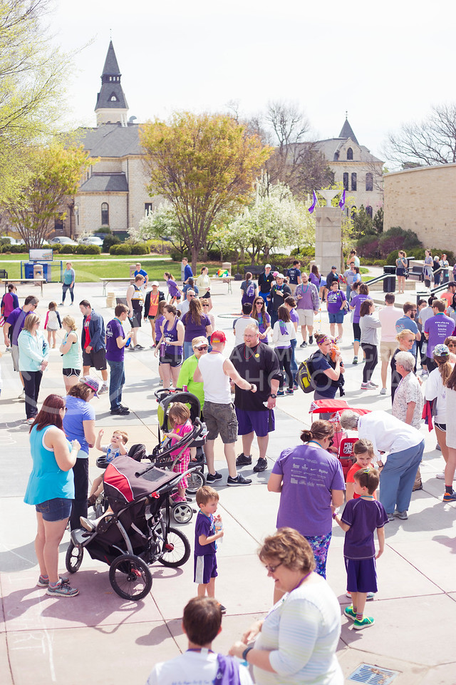 Participants wait for the Out of the Darkness Walk to begin in Bosco Plaza on April 8, 2017. (Anna Spexarth | The Collegian)