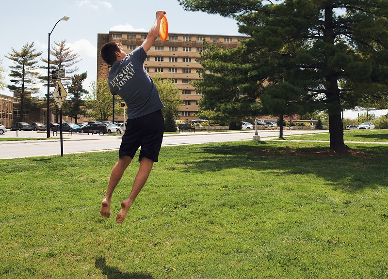 Carson Hughes, freshman in chemical engineering, stretches to catch an incoming frisbee. (Katelin Woods | Collegian Media Group)