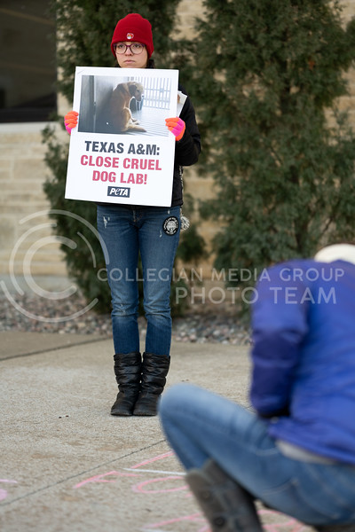 Animal rights activist lined up outside of Trotter Hall at Kansas State University to spread awareness on the dog testing labs located at Texas A&M. 02/20/20. (Dylan Connell | Collegian Media Group)