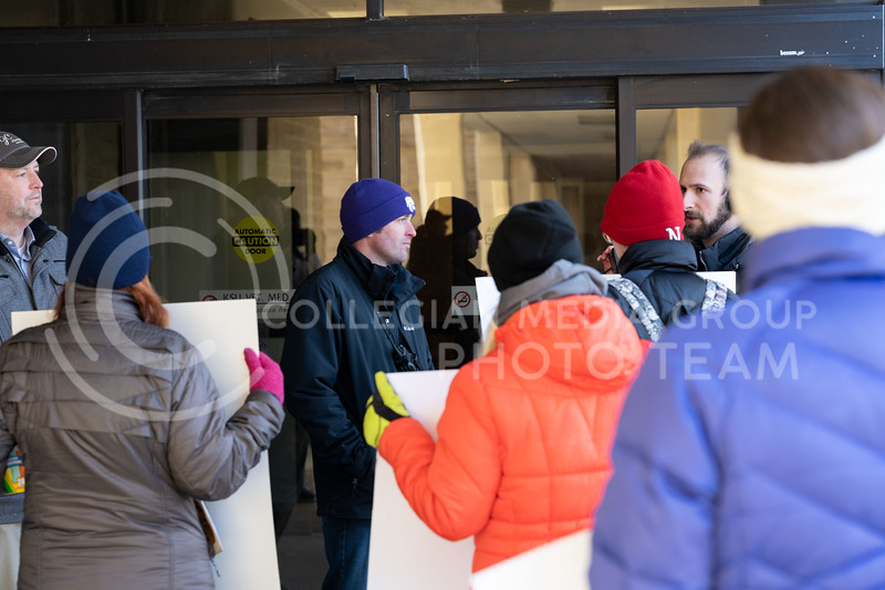 Animal rights activist lined up outside of Trotter Hall at Kansas State University to spread awareness on the dog testing labs located at Texas A&M. They were denied access as they attempted to make their way in. 02/20/20. (Dylan Connell | Collegian Media Group)