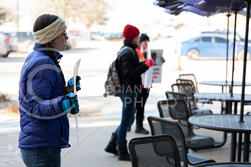 Animal rights activist lined up outside of Trotter Hall at Kansas State University to spread awareness on the dog testing labs located at Texas A&M. 02/20/20. (Dylan Connell   Collegian Media Group)