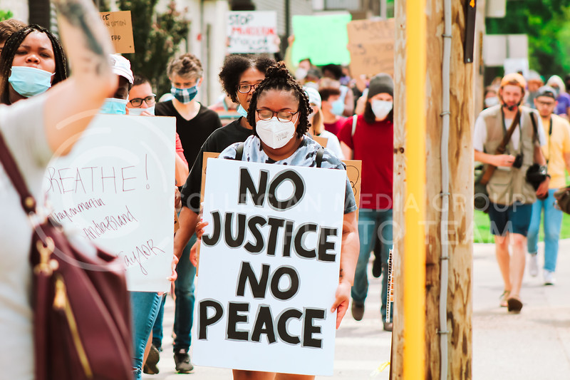 "In Manhattan, protesters met in Triangle Park on the morning of May 30 and marched down Bluemont Avenue chanting ""Say his name."" This protest, like hundreds across the United States, come on the heels of the police-involved death of George Floyd in Minnesota on Monday. (Angie Moss 