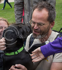 "Brian Hubbell, junior in criminology, pets a dog named Mack at the ""Pet Away Stress"" event in the Quad on Oct. 12, 2016. (Miranda Snyder 