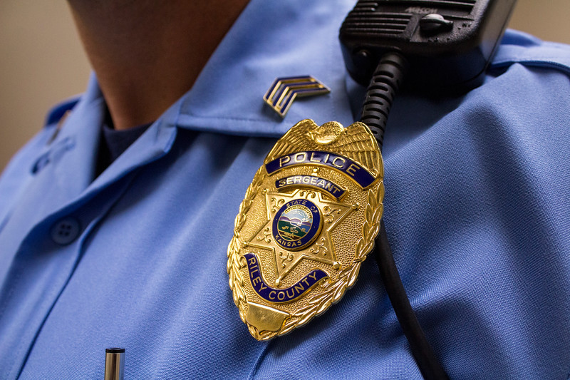 A Riley County Police badge rests on a Sergeant's uniform. (Andrea Klepper | Collegian Media Group)
