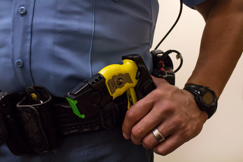 A Riley County Police Department officer holds onto his taser. (Andrea Klepper | Collegian Media Group)