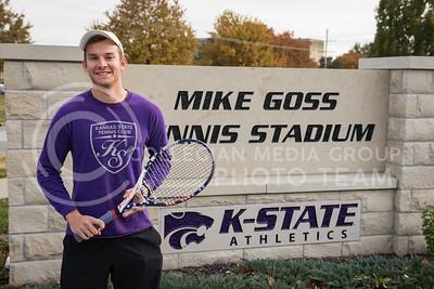Steven Wegner, senior in Marketing, stands in front of the Tennis Stadium sign at the K-State Recreational Center on Dec. 2, 2016. (John Benfer | The Collegian)