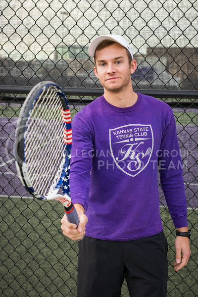 Steven Wegner, Kansas State Tennis Club President and senior in Marketing, stands in front of the tennis courts as he holds out his raquet at the K-State Recreational Center on Dec. 2, 2016. (John Benfer | The Collegian)