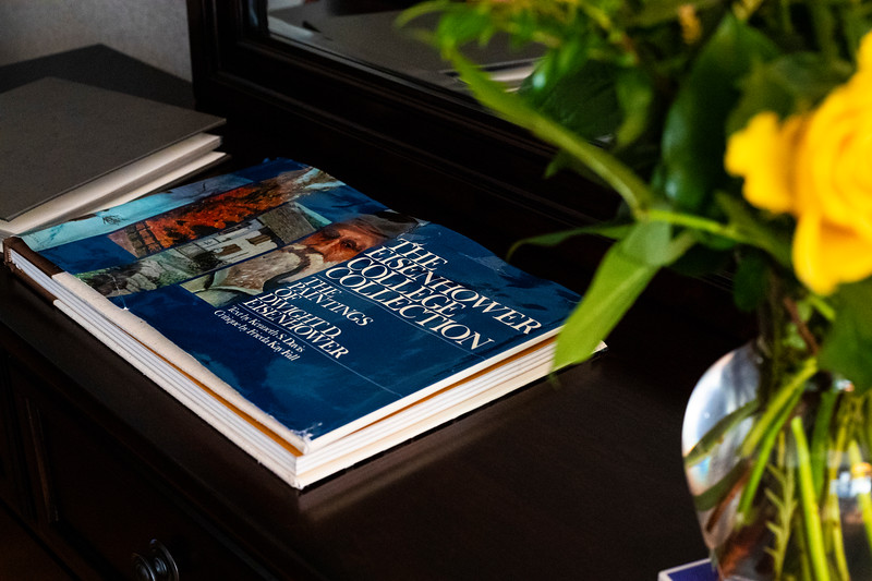 Book about the collection of Eisenhower paintings in the Eisenhower room at the presidents residence at Kansas State University ( Dalton Wainscott I Collegian Media Group)