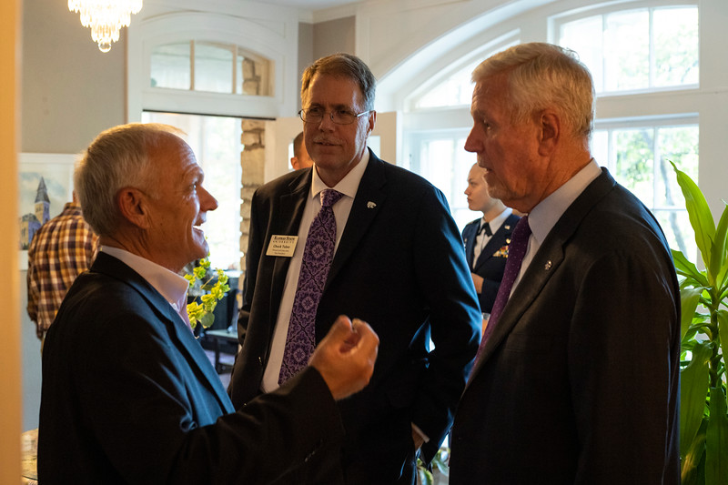 President Richard Meyers talks with Chief Academic Officer Chuck Taber at Eisenhower room dedication at the presidents residence at Kansas State University ( Dalton Wainscott I Collegian Media Group)