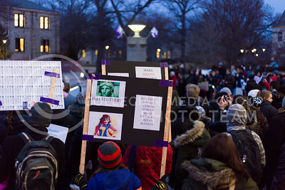 A rally-goer holds a sign on campus during the Manhattan Kansas Solidarity Rally that was in held in Bosco Plaza on February 1, 2017. The rally was held in protest of President Trump's recent executive order regarding immigration. (Anna Spexarth | The Collegian)