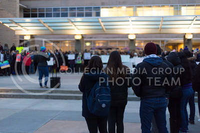 People rally at the Manhattan Kansas Solidarity Rally that was in held in Bosco Plaza on February 1, 2017. The rally was held in protest of President Trump's recent executive order regarding immigration. (Anna Spexarth | The Collegian)