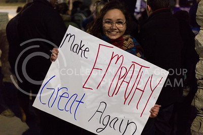 Valerie Mays, sophmore in anthropology, holds a sign on campus after the Manhattan Kansas Solidarity Rally that was in held in Bosco Plaza on February 1, 2017. The rally was held in protest of President Trump's recent executive order regarding immigration. (Anna Spexarth | The Collegian)