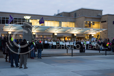 People rally in Bosco Plaza outside the K-State Student union at Manhattan Kansas Solidarity Rally that was in held on February 1, 2017. The rally was held in protest of President Trump's recent executive order regarding immigration. (Anna Spexarth | The Collegian)