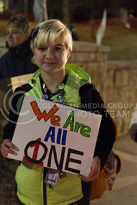 Cynthia Ferguson, junior in computer science, holds a sign sign on campus after the Manhattan Kansas Solidarity Rally that was in held in Bosco Plaza on February 1, 2017. The rally was held in protest of President Trump's recent executive order regarding immigration. (Anna Spexarth | The Collegian)