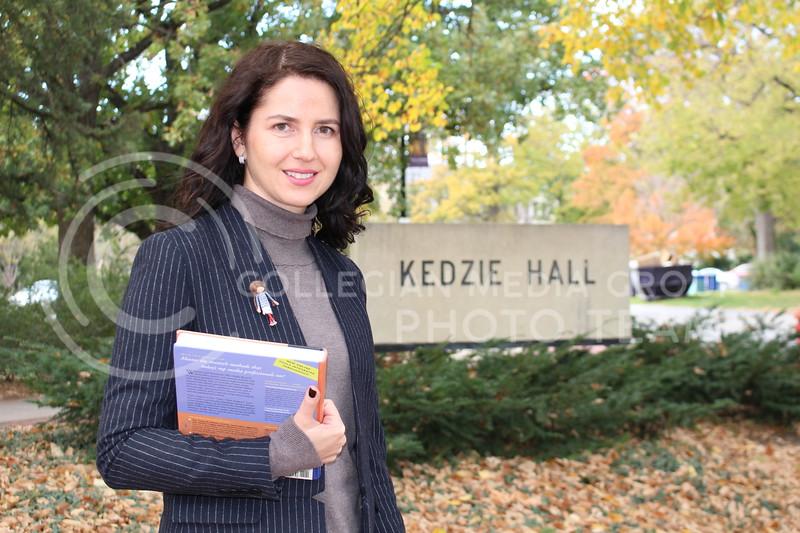 Raluca Cozma, associate professor of journalism and mass communications, stood outside Kedzie Hall on Nov. 2, 2017.<br /> (Tiffany Roney | Collegian Media Group)