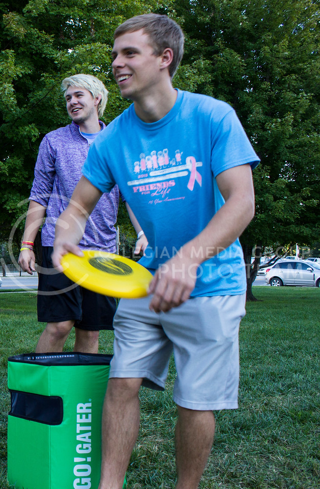 Caleb Sutton and Hayden Splechter, both freshmen in mechanical engineering, trow a frisbee at the Wefald and Goodnow resident hall block party. (Regan Tokos | The Collegian)