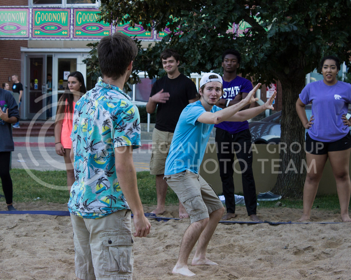 John Adams, freshman in electrical engineering, clebrates a good hit over the net for the Goodnow residents hall team at the Goodnow and Wefald block party. (Regan Tokos | The Collegian)