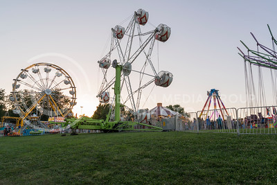 Rides light up as the sun sets over CiCo Park and the Riley County Fair on July 21, 2016. (Evert Nelson | The Collegian)