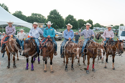 Men on horseback line up in position behind Wells Arena on July 21, 2016 during the Kaw Valley Rodeo at the Riley County Fairground in CiCo Park. (Evert Nelson | The Collegian)