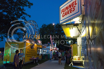 Funnel Cakes, ribeye steak and fried Oreos are a couple options available through food vender on July 21, 2016 at the Riley County Fair in CiCo Park. (Evert Nelson | The Collegian)
