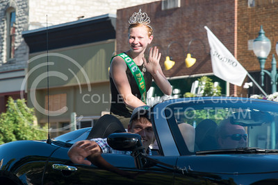 Georgia Hatesohl waves to patrons during the County Fair parade on July 21, 2016 through Poyntz Avenue. Hatesohl is the 2016 Fair Royalty along with Ty Ruckert. (Evert Nelson | The Collegian)